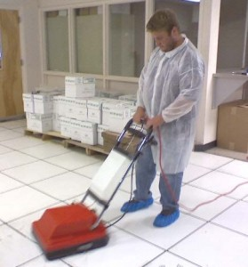 Cleaning and polishing raised flooring panels using specialized, high-suction equipment