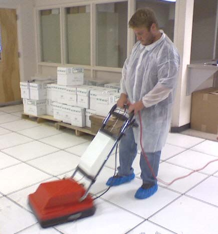 Cleaning And Polishing Raised Flooring Panels Using Specialized,  High Suction Equipment